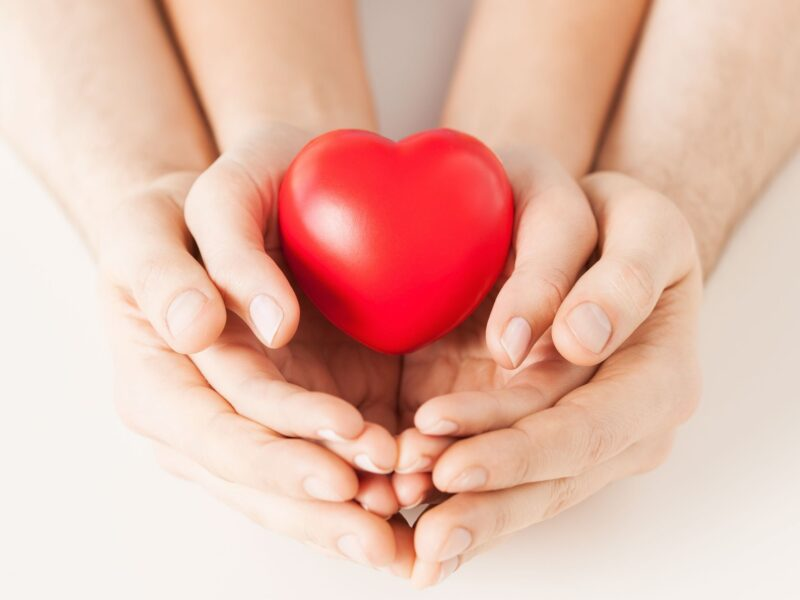 19638520 - close up of woman and man hands with heart